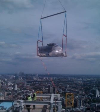 generator being craned to the top of Heron Tower