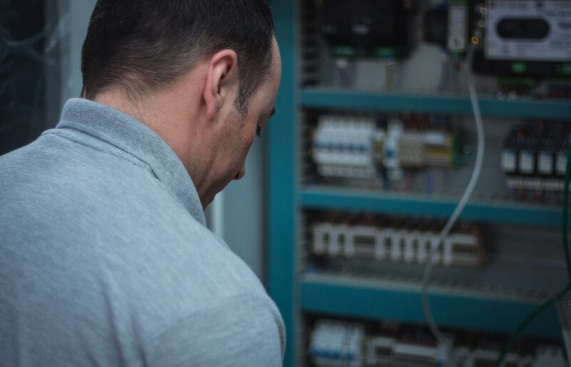 Photo of Andy Thompson working on an electronic circuit board
